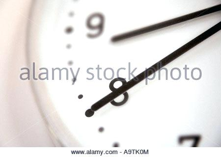 modern clock face modern clock face showing hands and the numbers eight and nine stock photo